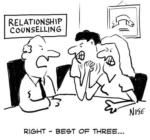 Couple arm-wrestling at ralationship counselling office